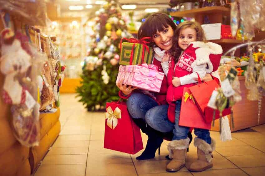 mom and daughter collecting gifts for holidays