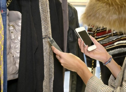 Digital shopping apps, like QR readers, can help you save money in the store, helping to control your clothing budget