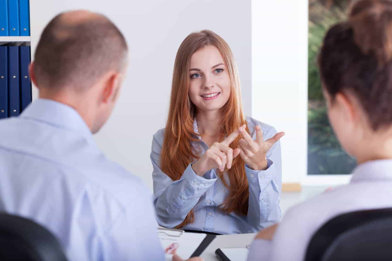 Young clever woman during her job and money conversation