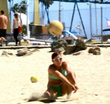 Volleyball player bending low to dig the ball offers personal financial advice