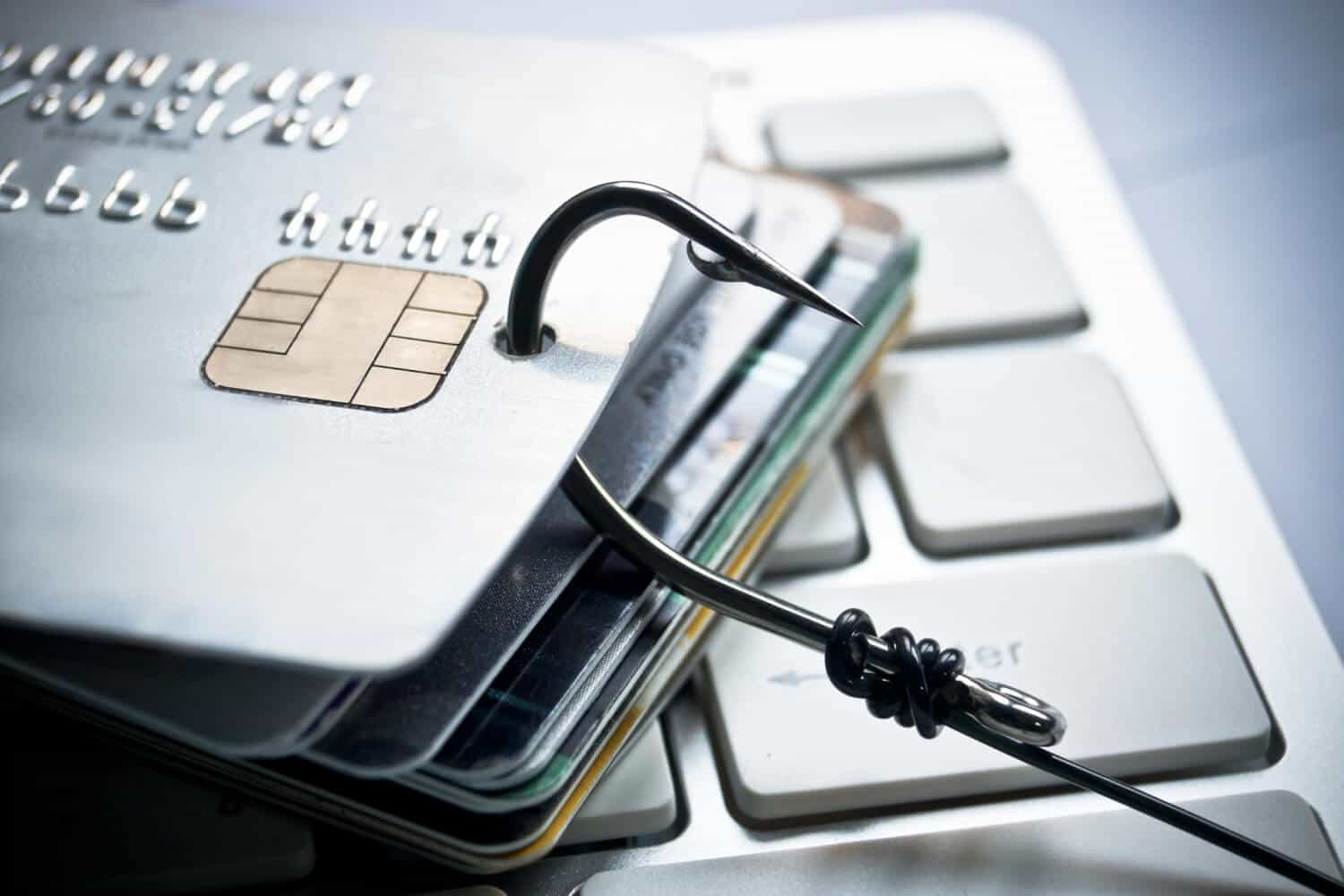 Credit cards with hooks through them represents phishing, something IT departments must learn to be wary of