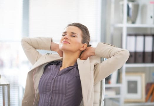 Relaxed business woman in office