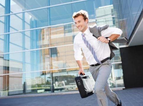 Image of an excited man leaving his job who has achieved a work-life balance