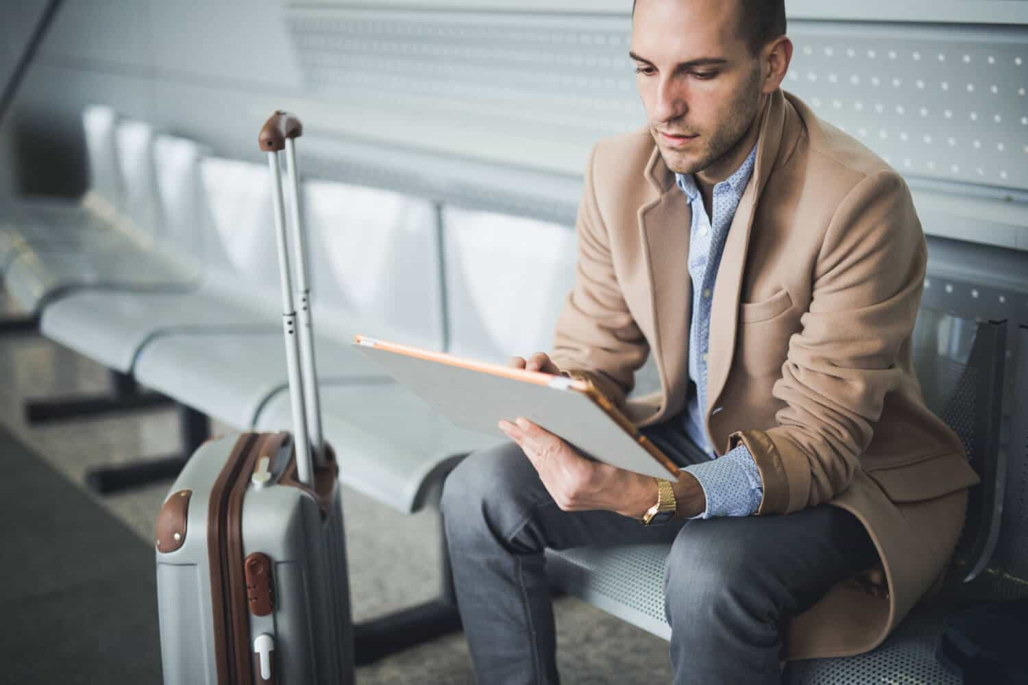 Overseas workers like this man waiting at the airport see positives and negatives to the job