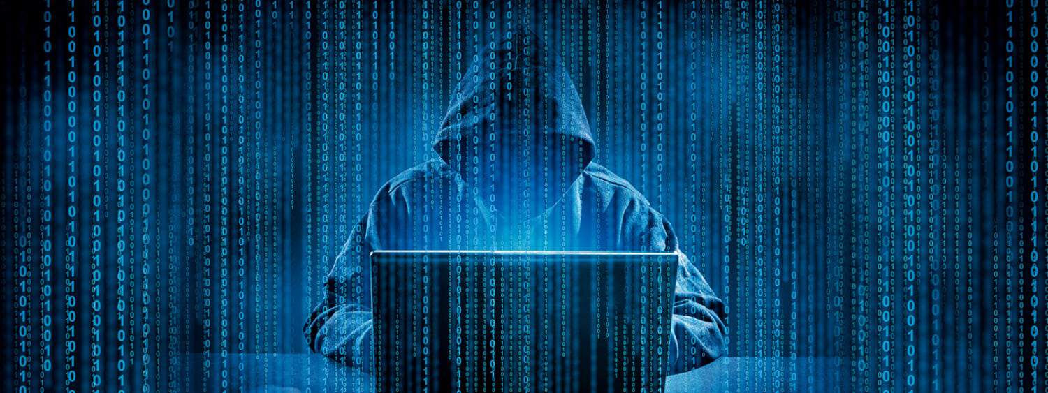 A super hacker in a hoodie breaks into your computer security using his laptop