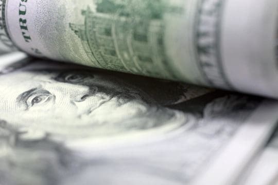 A stack of $100 bills is why you need to read about these money facts