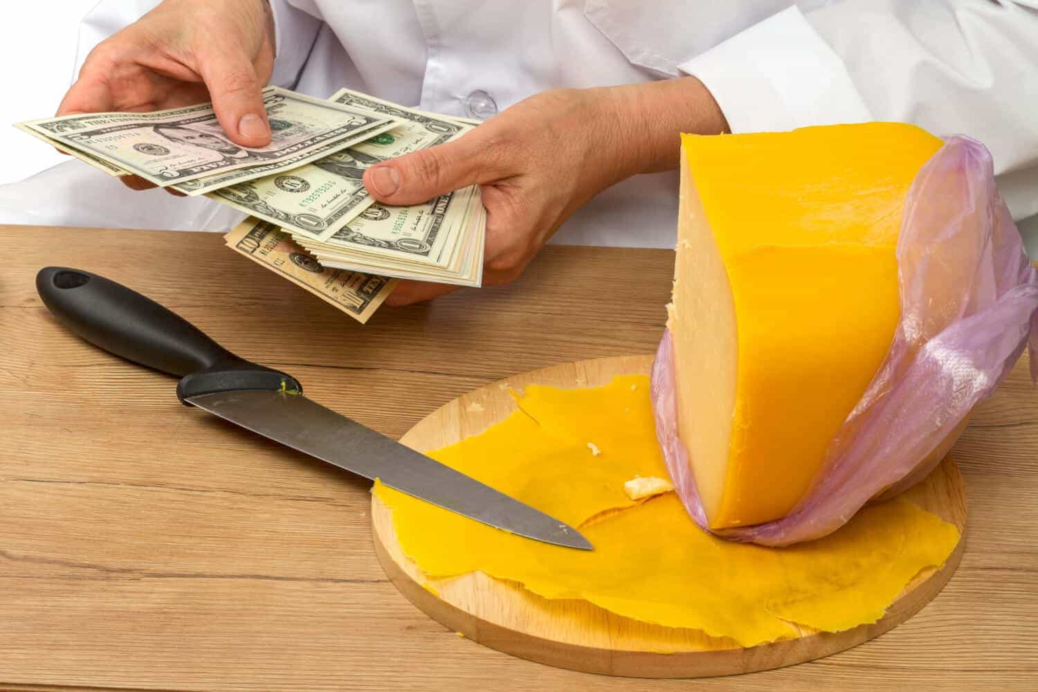 A man with a block of cheese counts his discretionary income