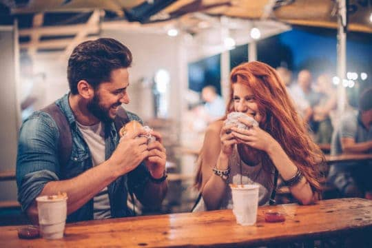 This couple is not revealing debt on a first date, which is probably why they're smiling