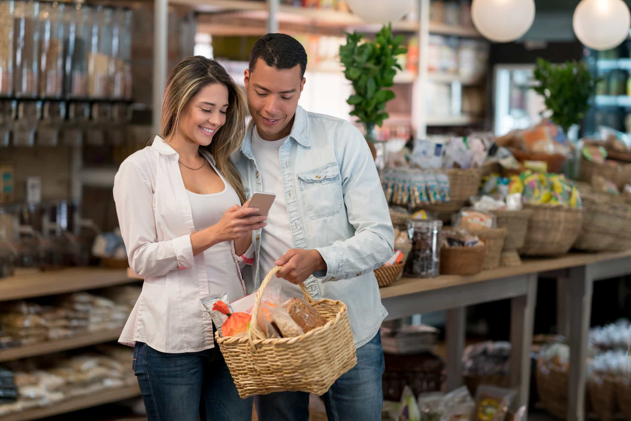 Latin American couple shopping at the grocery store