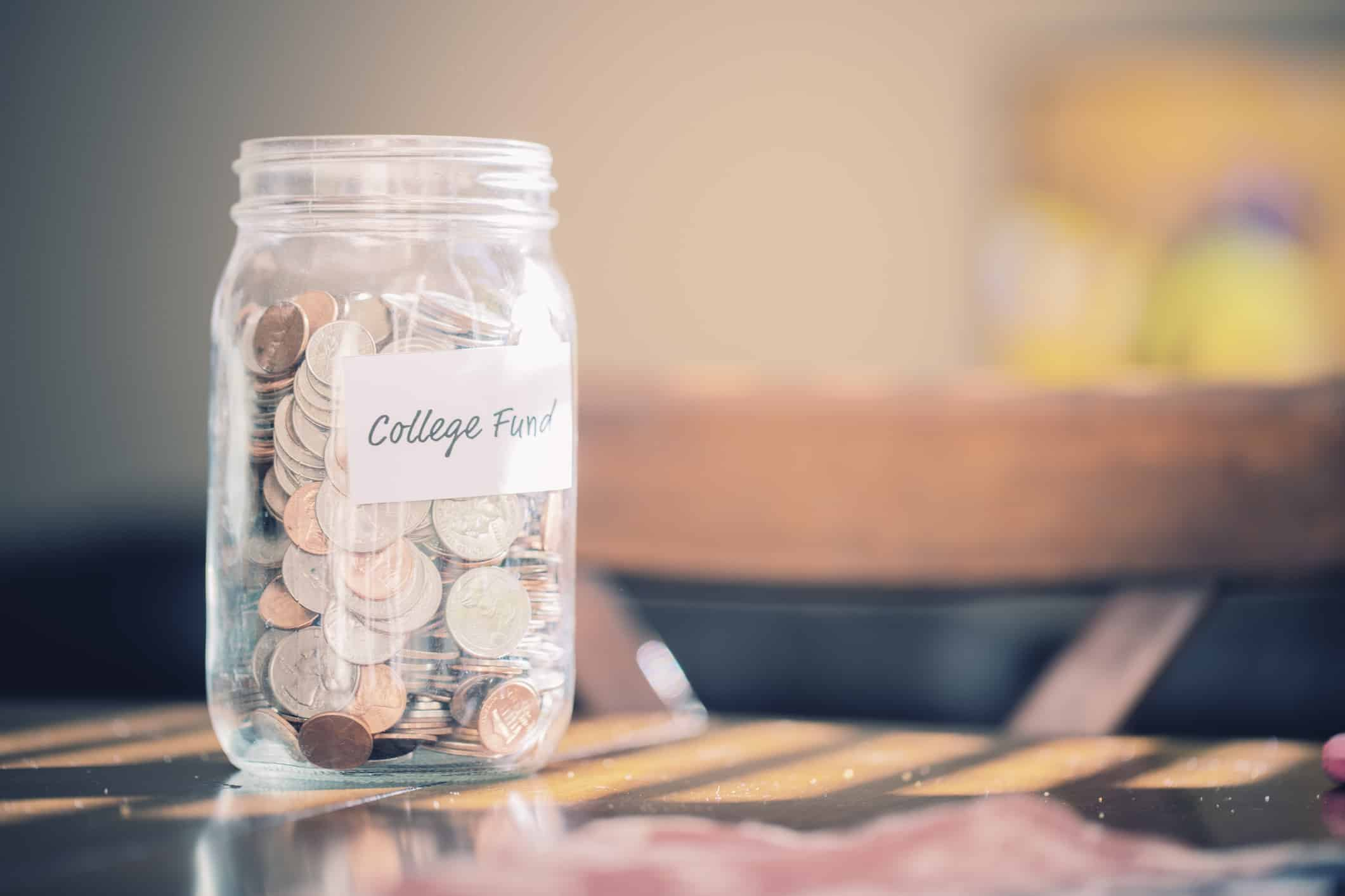 A jar full of change for a college savings fund