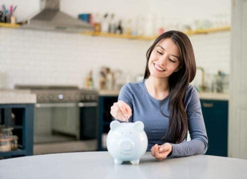 A woman found monthly savings and put them in her piggy bank