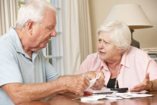 Elderly couple reviewing their bills