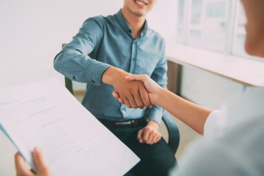 Shaking hands after a successful job interview