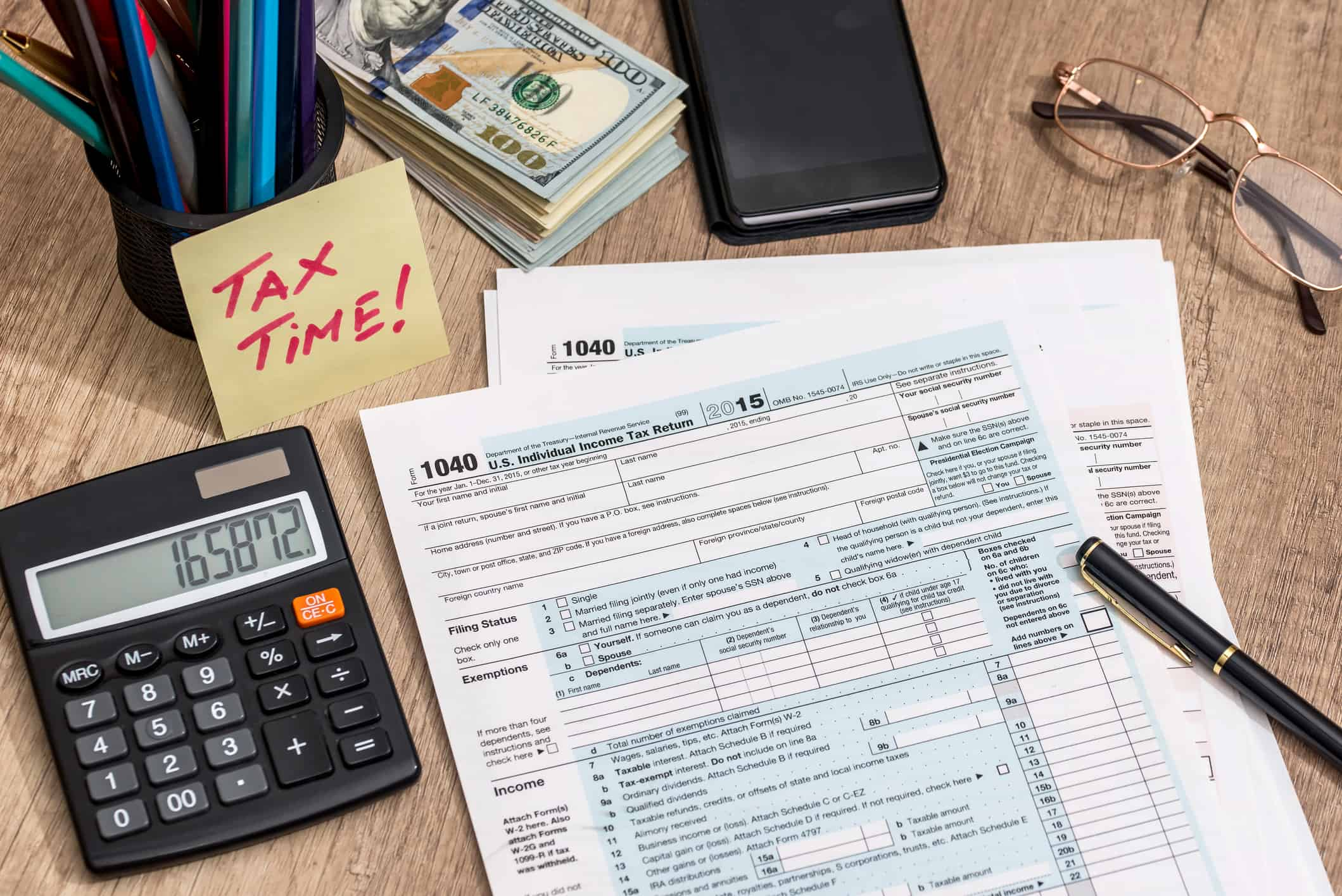 Calculator, 1040 paperwork and other tax filing tools