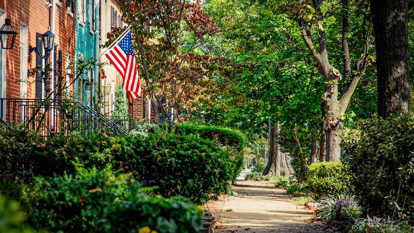 Brick houses and a flag on a Virginia street