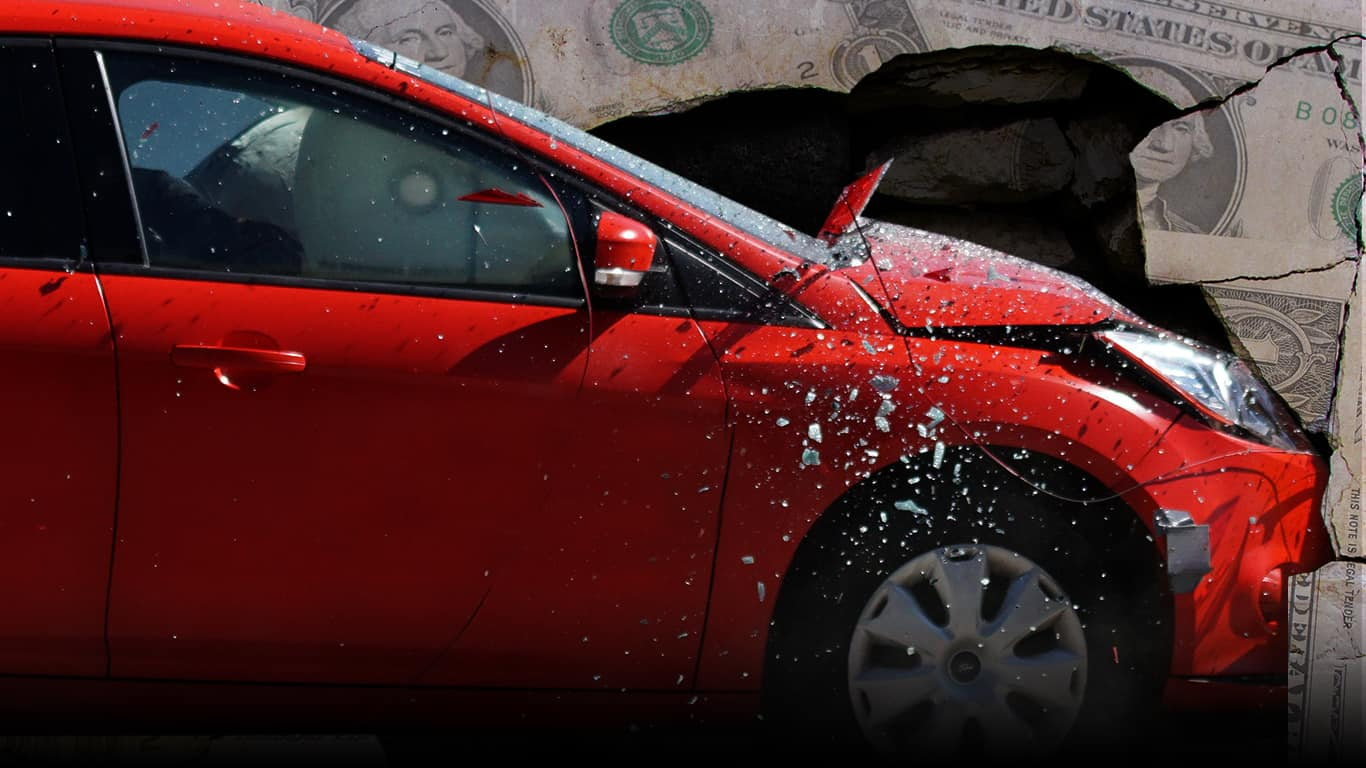 A car crashes into a wall made out of dollar bills signifying auto loan debt (illustrated)