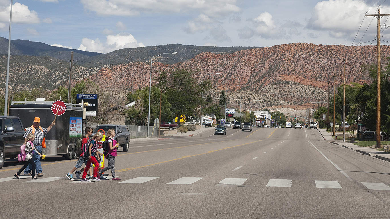 Kids crossing the street to elementary school in Cedar City, Utah