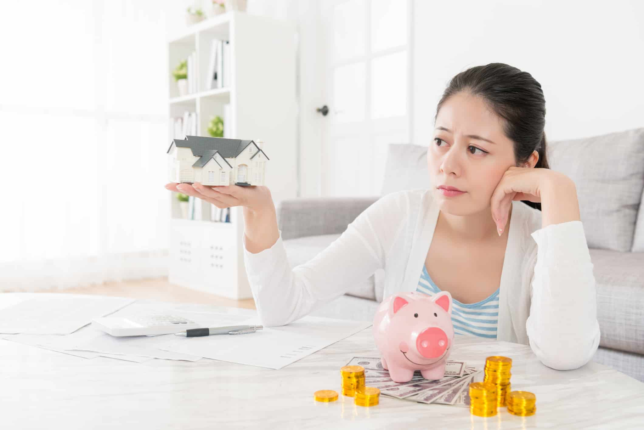 Women deciding how much she will sacrifice to purchase a home.
