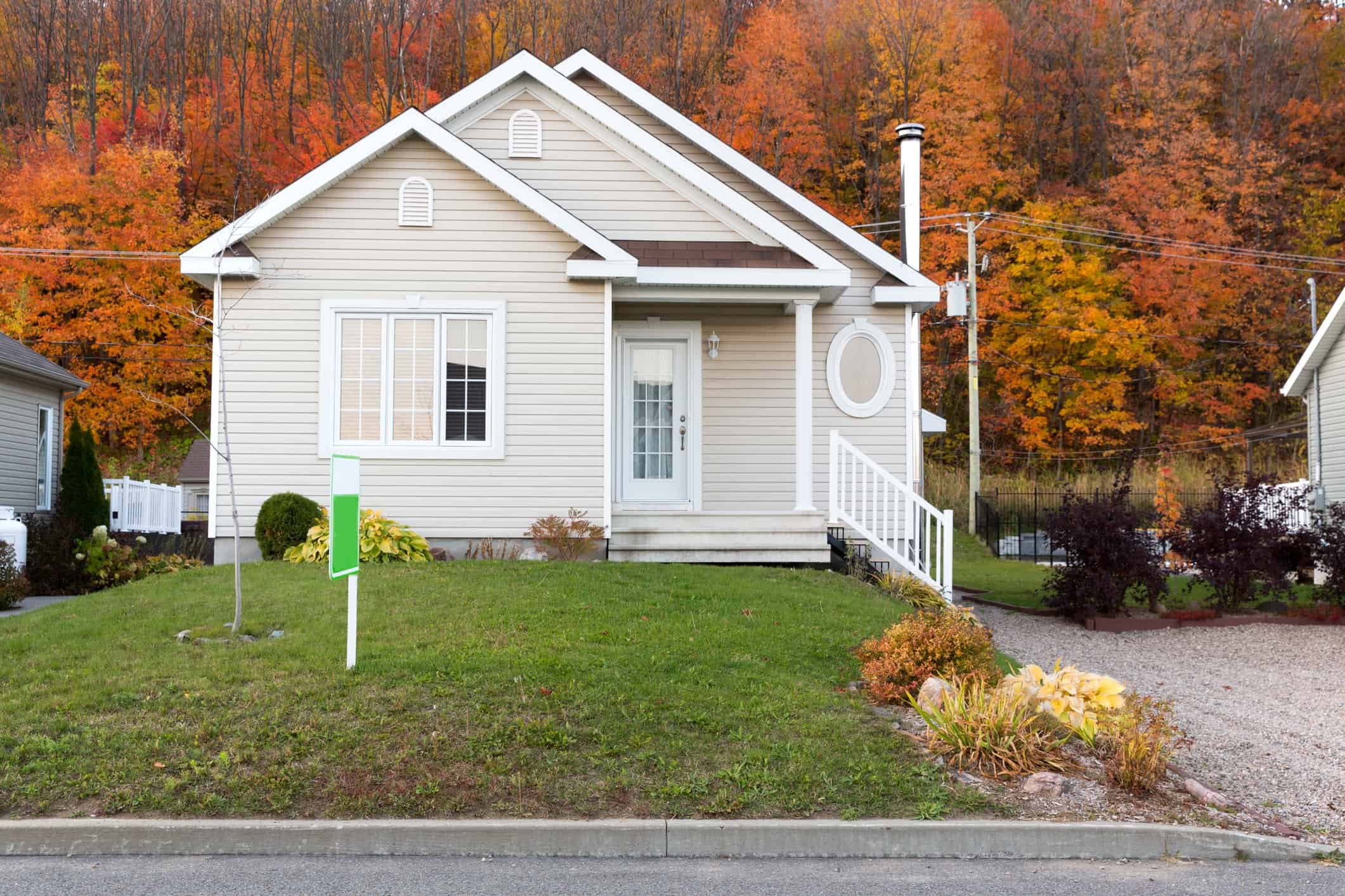 A small home for sale in a residential neighborhood.