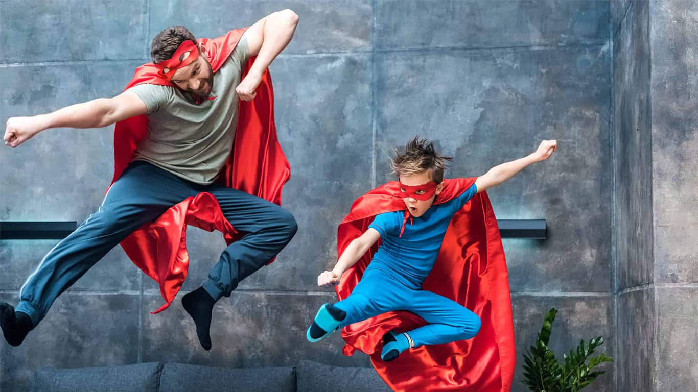 Father and son dress up like superheroes