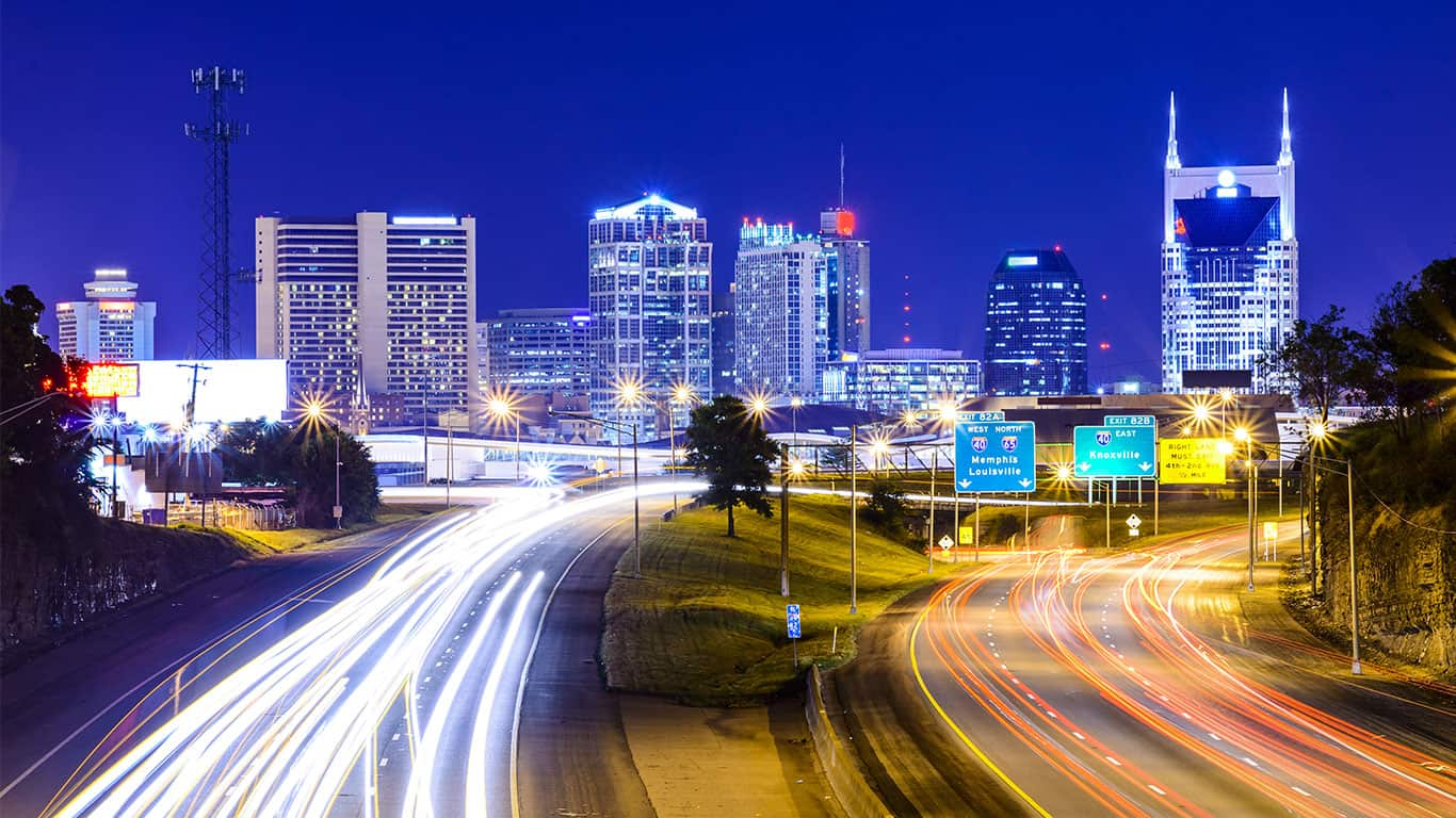 Nashville downtown and highway at night with blurred traffic