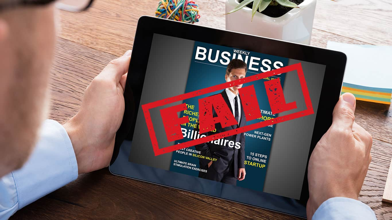 Man looking at expensive ipad with business magazine on cover with FAIL over it