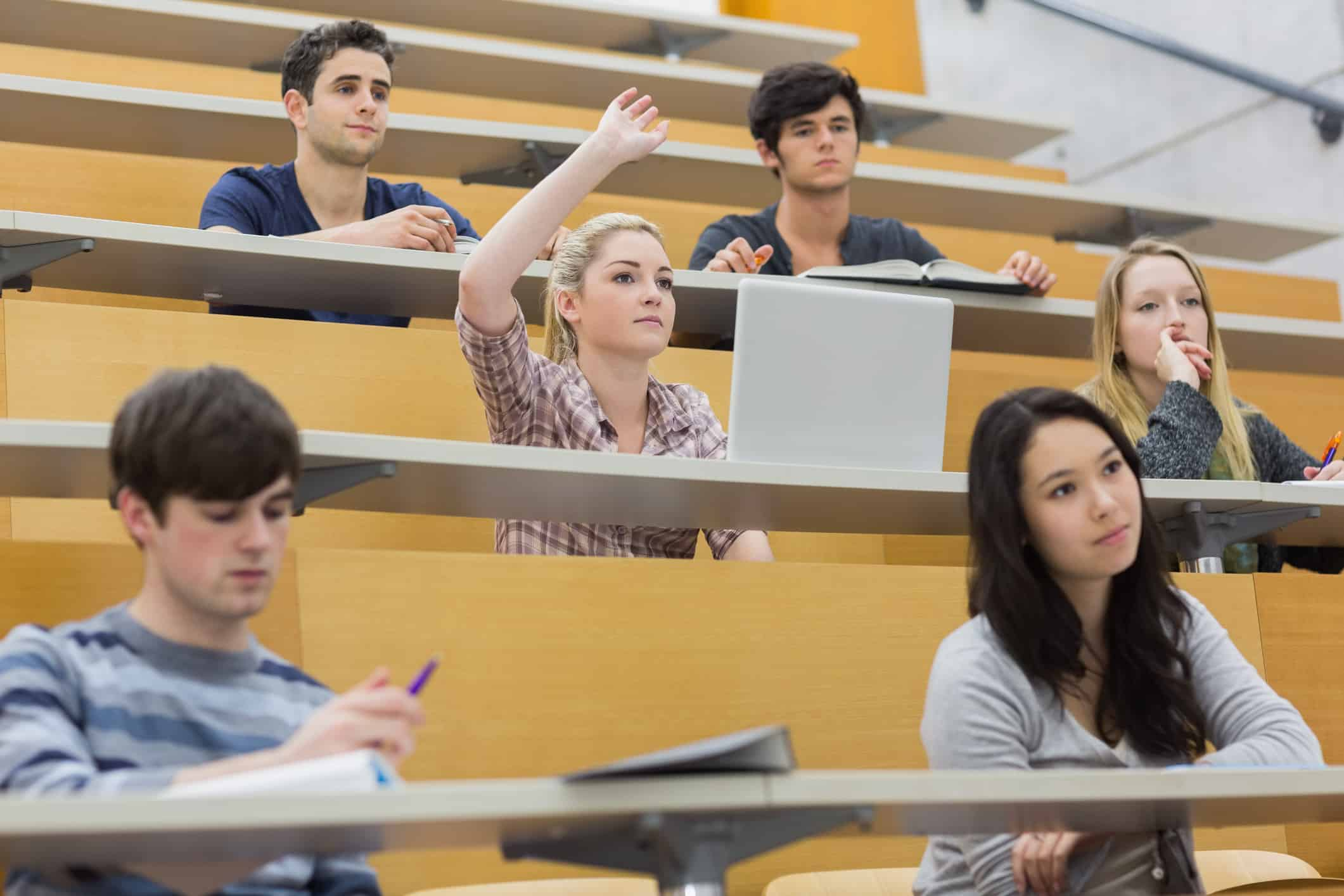 Lecture hall with only a few young students in student loan debt