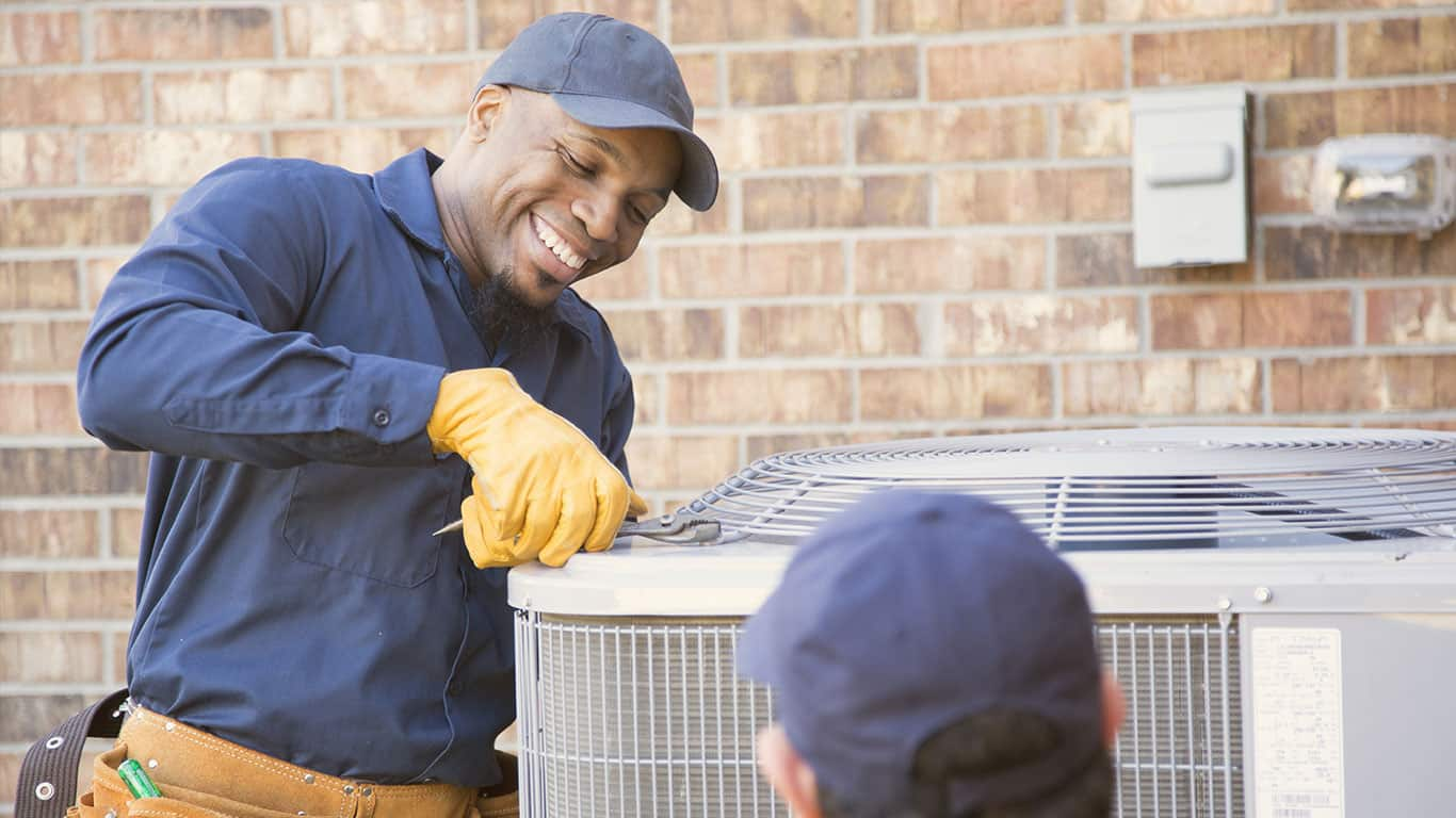 Hired HVAC Mechanic fixing air condition unit at residential home