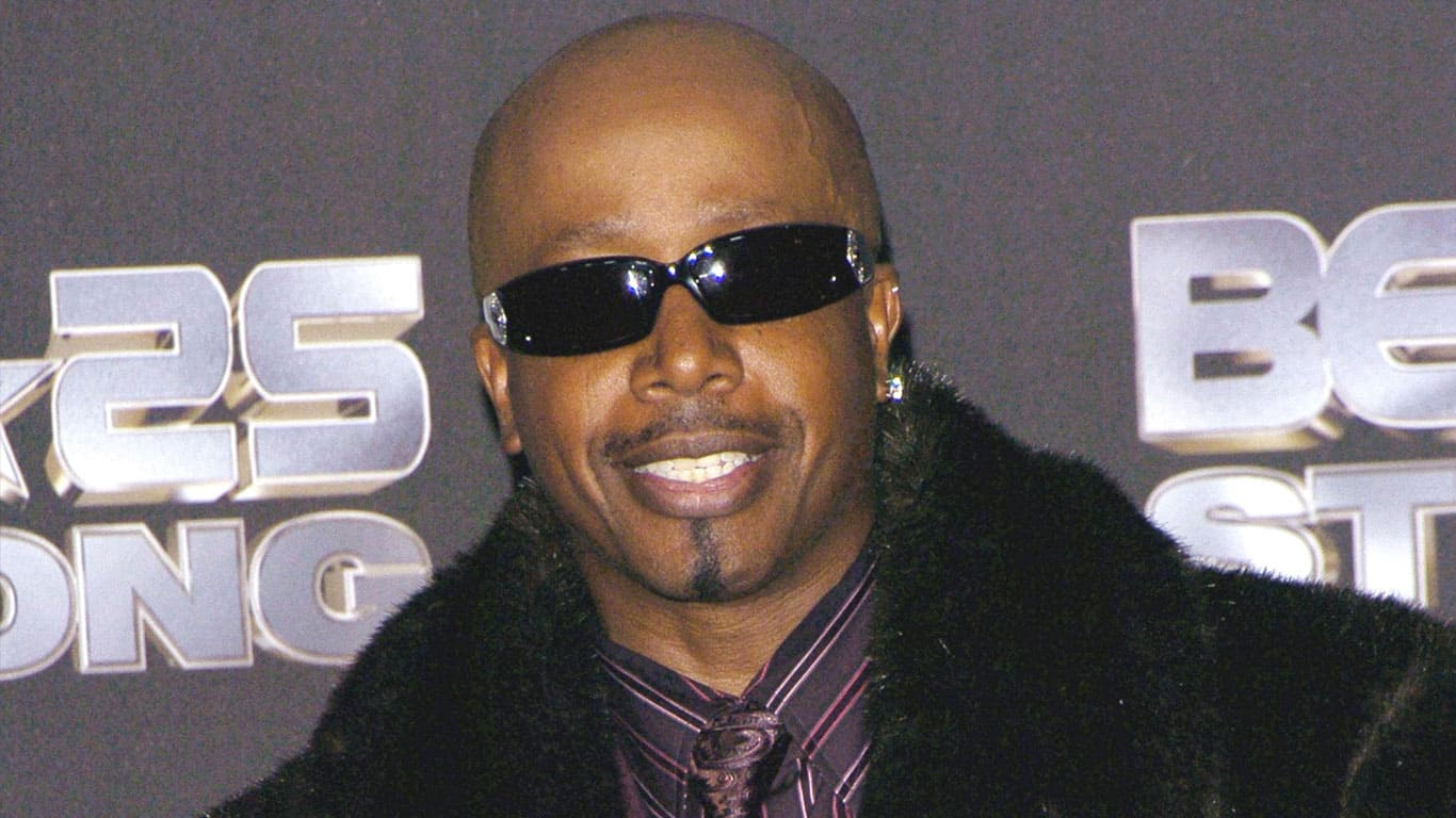 MC Hammer wearing black sunglasses and black fur coat at the BET Silver Anniversary Celebration
