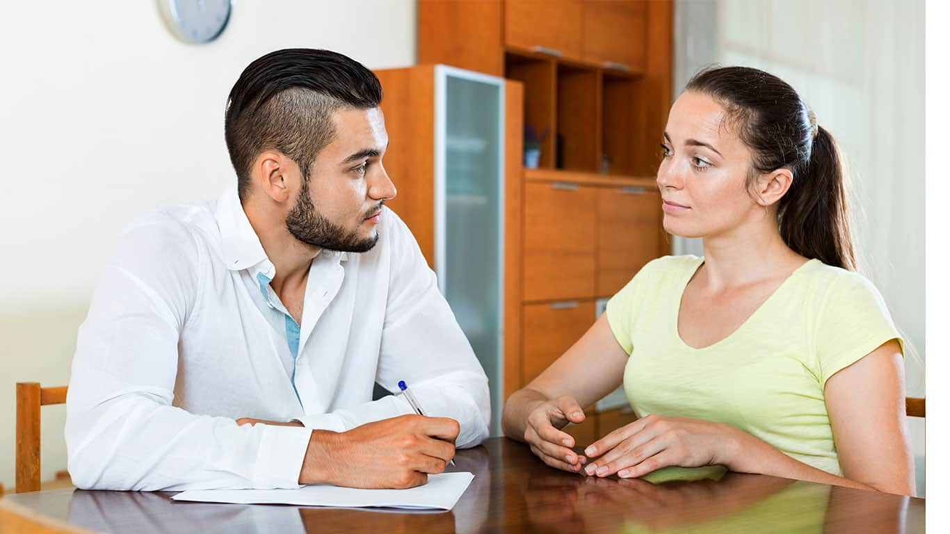 Worried pair discussing financial problems