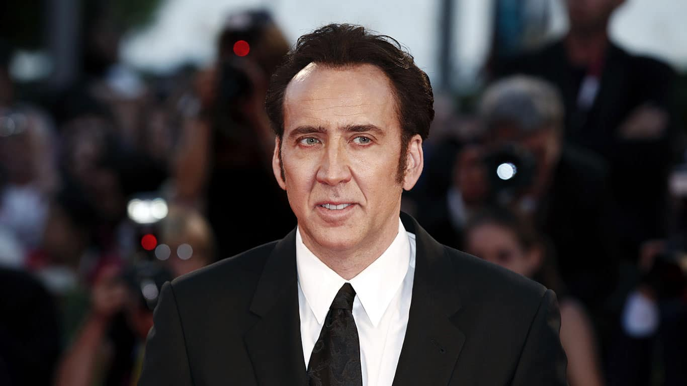 Nicolas Cage Wearing a Black Suit and Tie at Venice Film Festival