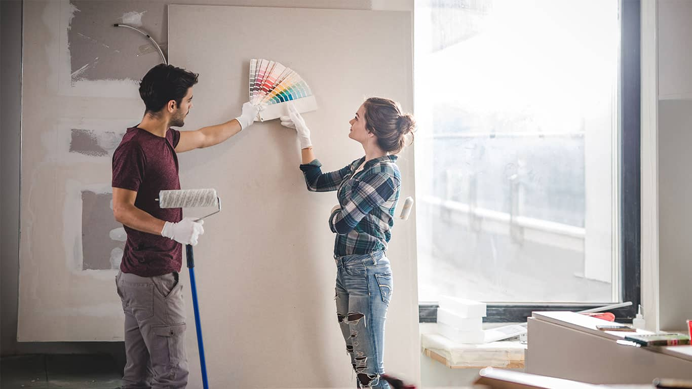 Couple choosing paint colors for a new home