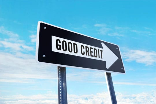 Can you get a perfect credit score? Traffic sign'good credit' traffic sign in front of clear sky.
