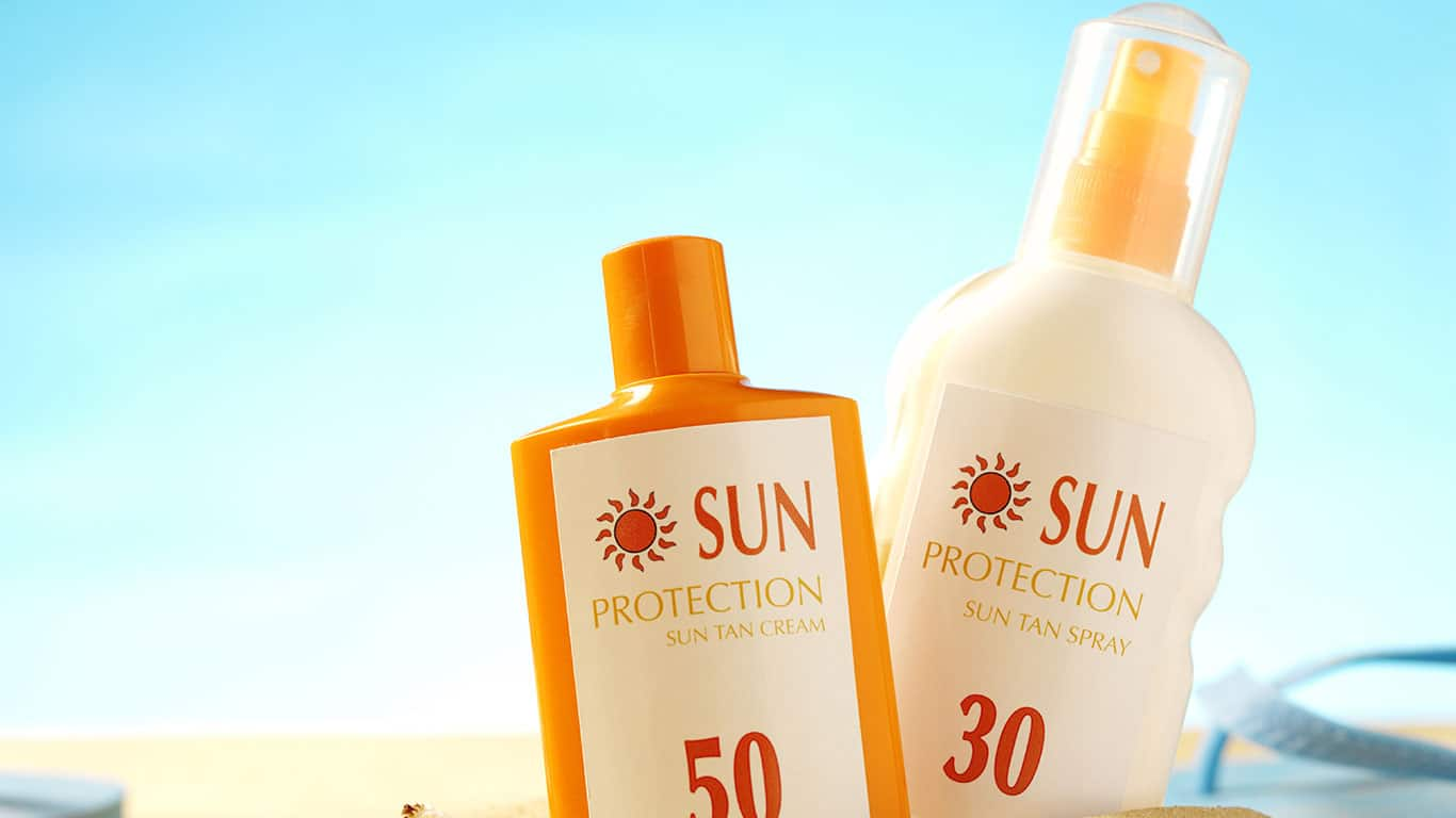 Low cost sunscreen bottles at beach