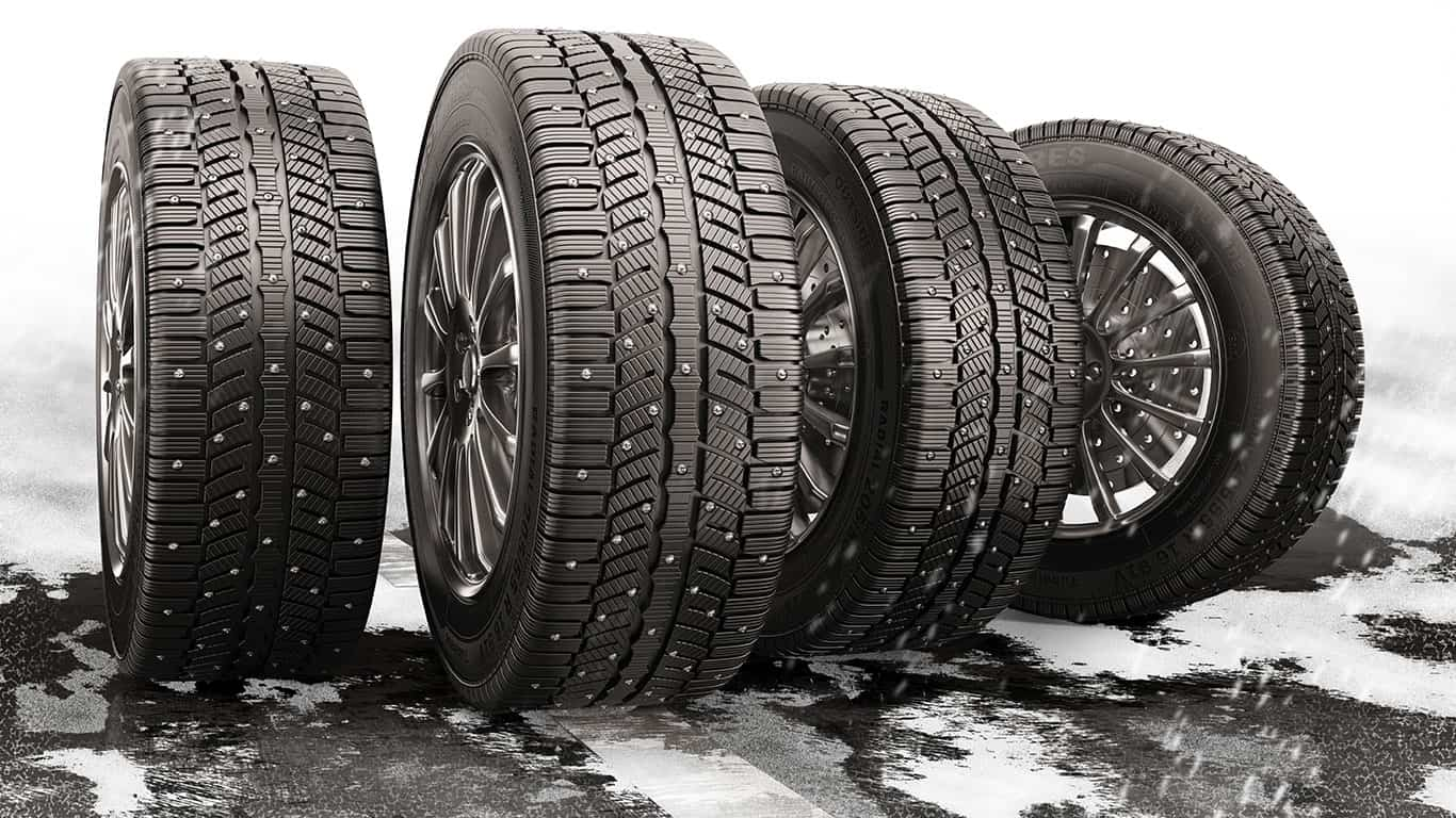 Pricey tires on a road with snow