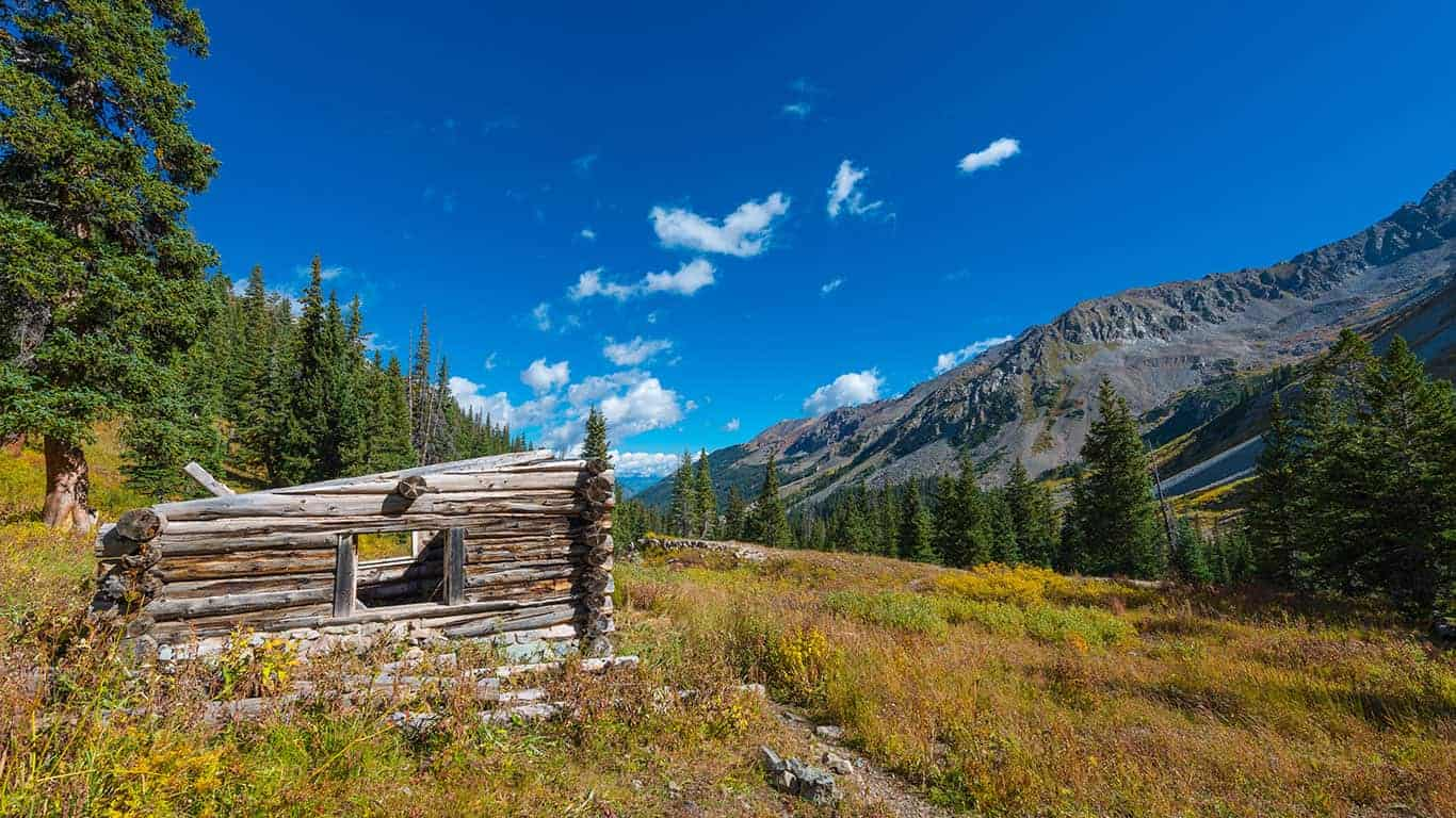 The remains of a wooden cabin lie in a remote mining ghost town