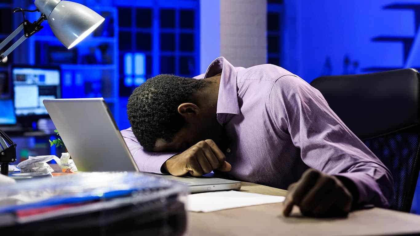 Tired african businessman stressing over loans