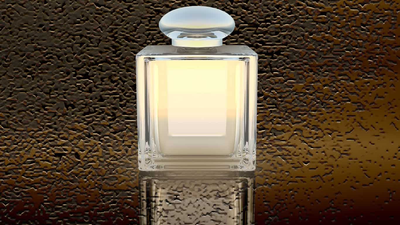 Perfume in a glass bottle on a dark background