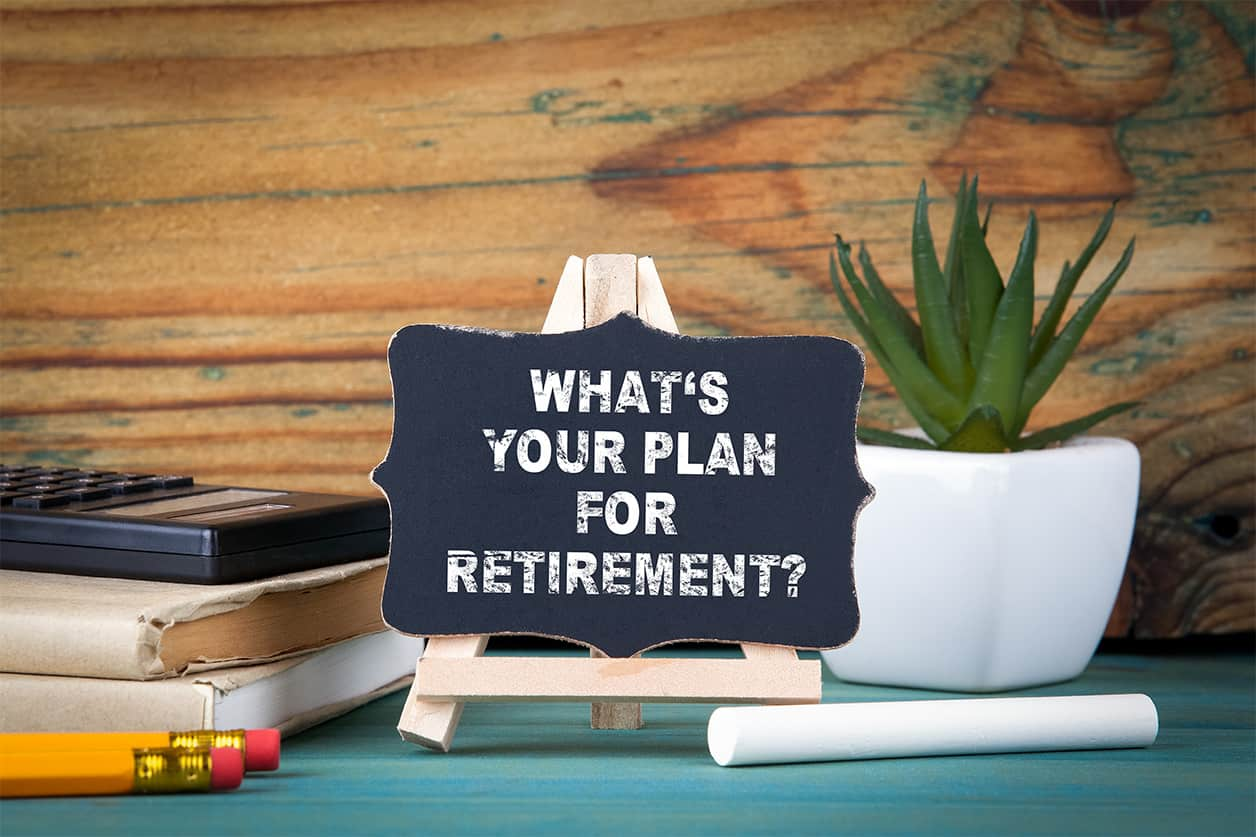 What's your plan for retirement. small wooden board with chalk on the table. Half of middle-aged Americans are unprepared for retirement.