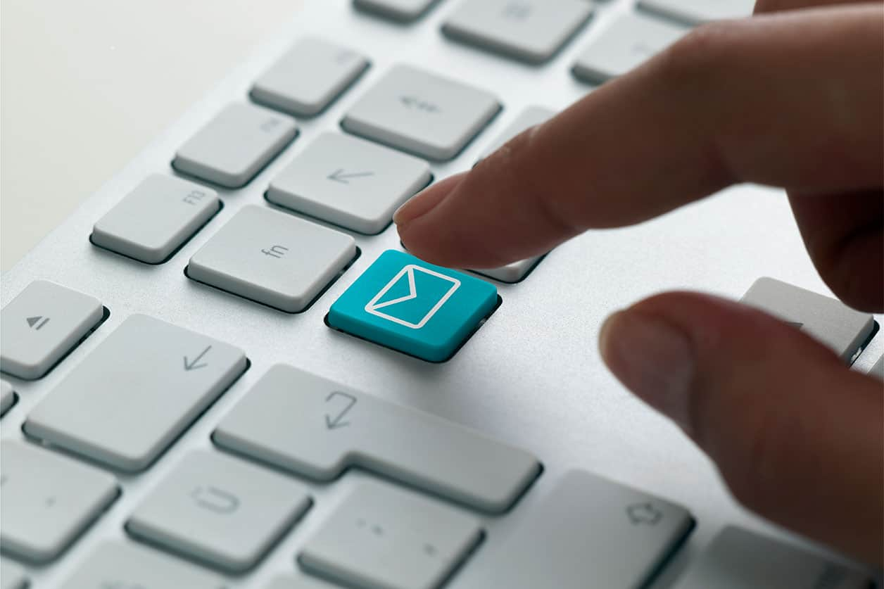 Business e-mail on a computer keyboard