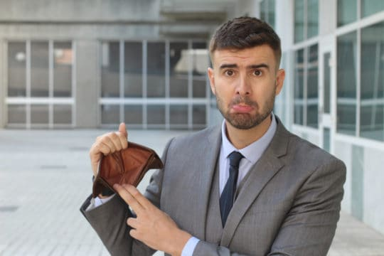Sad entrepreneur with zero money due to his money mistakes.