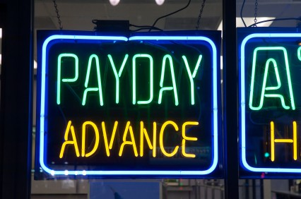 Payday advance sign in a storefront window