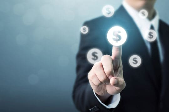 Businessman pointing dollar currency icon