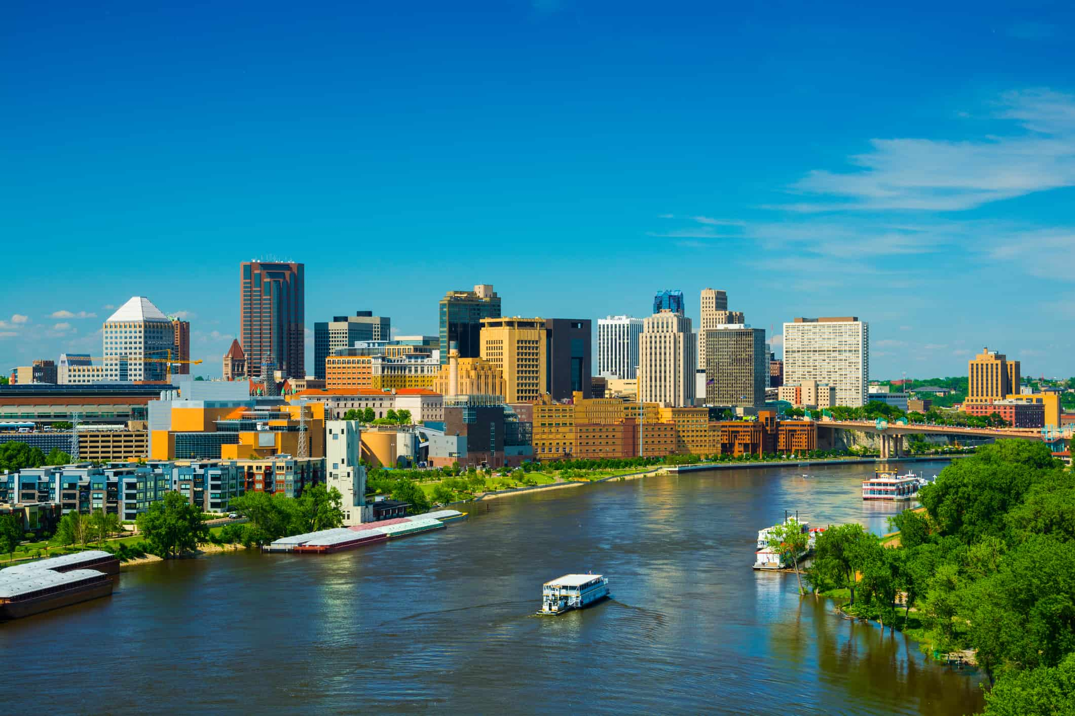 Saint Paul downtown skyline with the Mississippi River in the foreground. Saint Paul is part of the Minneapolis - Saint Paul Twin Cities area.