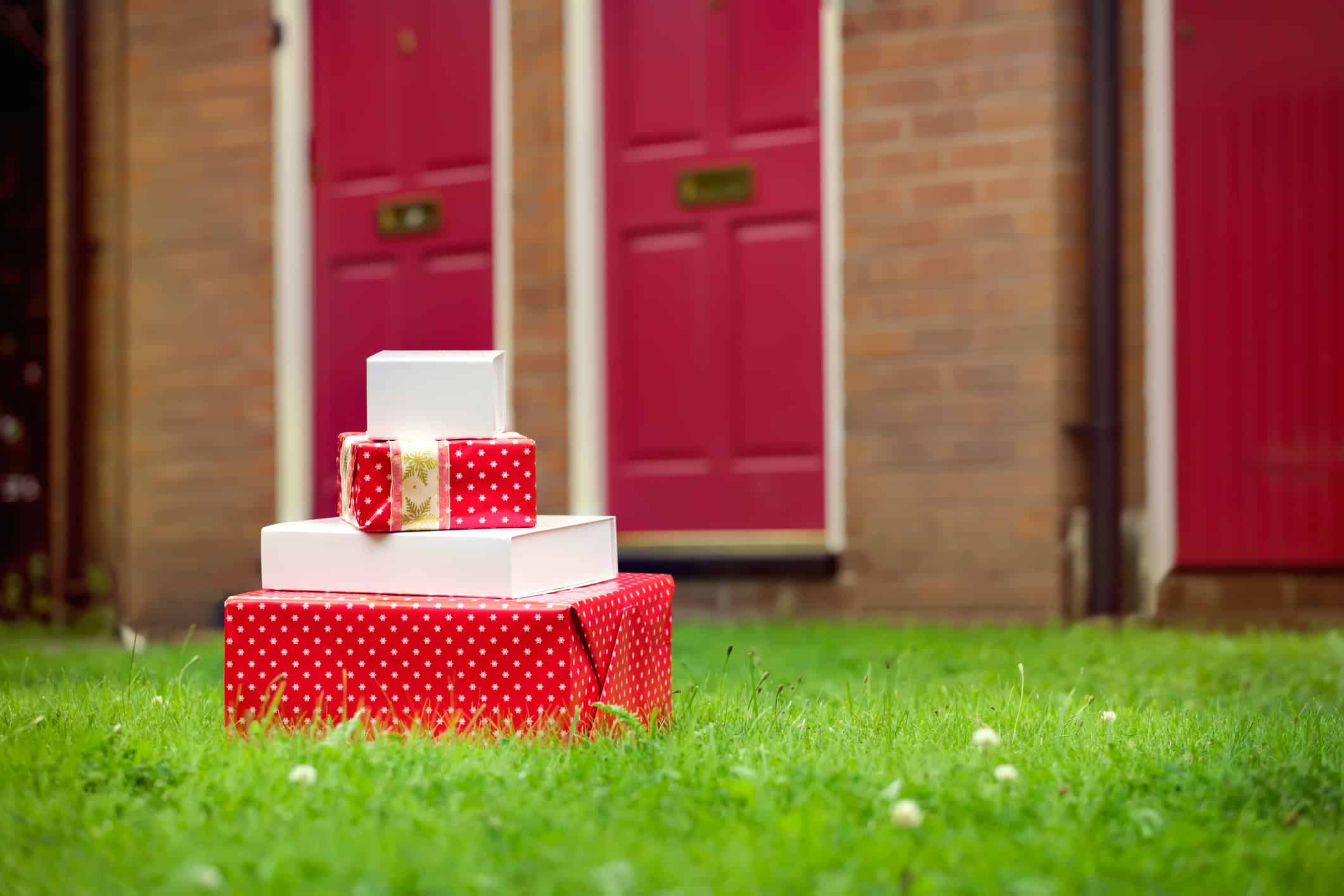 Christmas gift boxes delivered to house front door.